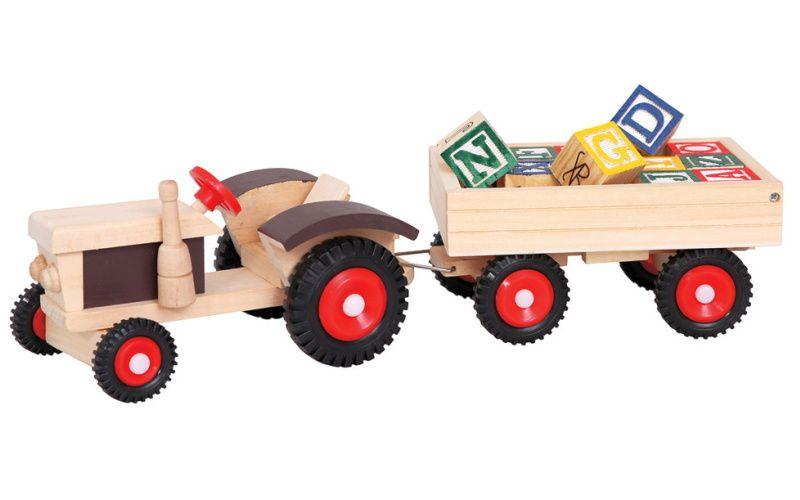 Traktor s gumovými koly a vlečkou ABC